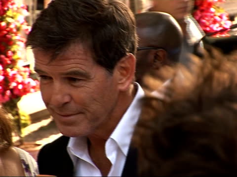 arrivals at 'mamma mia' film premiere pierce brosnan as interviewed by press - mamma mia stock videos and b-roll footage