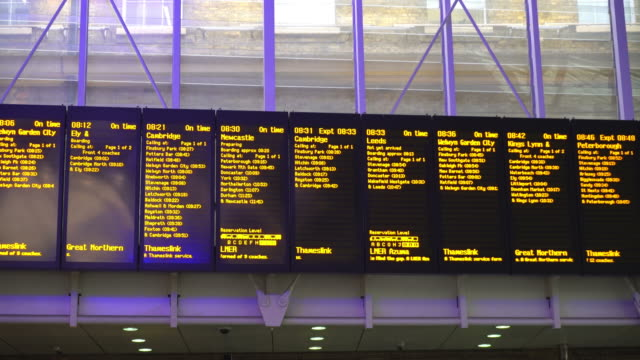 arrivals departure board, airport & train at london king's cross station - waiting stock videos & royalty-free footage