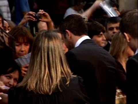 Arrivals for 'RocknRolla' film premiere Back view Gerard Butler signing autographs for fans