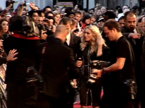 arrivals for 'rocknrolla' film premiere england london leicester square photography ** guy ritchie and wife madonna along red carpet at film premiere... - madonna singer stock videos and b-roll footage