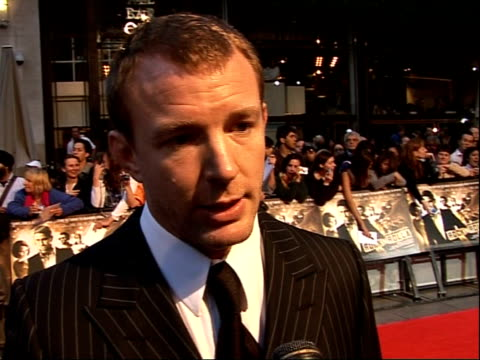 arrivals for 'rocknrolla' film premiere; guy ritchie interview sot - talks about madonna helping him on set - isn't that part of what wives should... - sherlock holmes stock videos & royalty-free footage