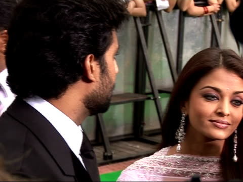 Arrivals on the red carpet at IIFA awards Abhishek Bachchan arriving chatting to reporters / Bachchan with his wife actress Aishwarya Rai as both...