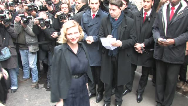 arrives at the Chanel Haute Couture show at Paris Fashion Week A/W 2011 Kirsten Dunst on January 25 2011 in Paris France