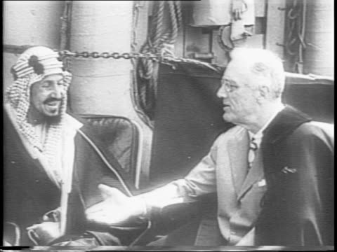 vídeos y material grabado en eventos de stock de fdr arrives by plane car and boat in egypt for suez summit / king farouk arrives onboard naval ship with honor guard / haile selassie arrives /... - franklin roosevelt