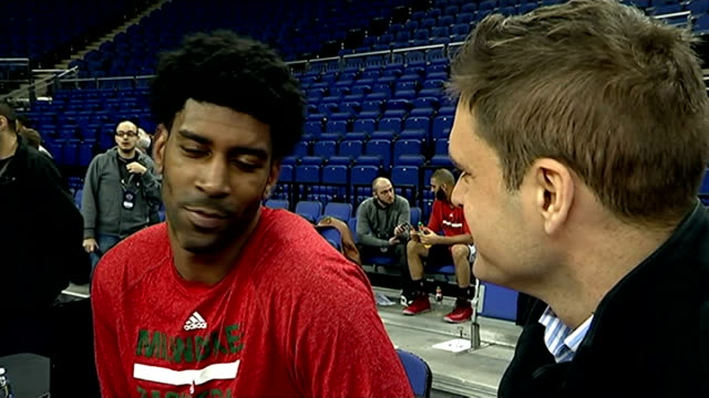 NBA arrives London OJ Mayo interview SOT Great experience Basketball through hoop PULL OUT reporter to camera Carmelo Anthony towards through press...