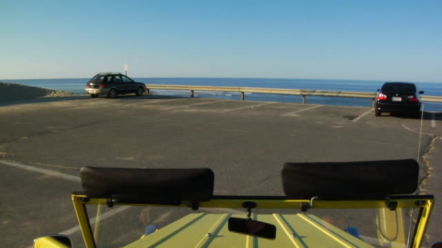 pov, suv arriving at beach parking lot, north truro, massachusetts, usa - sports utility vehicle stock-videos und b-roll-filmmaterial