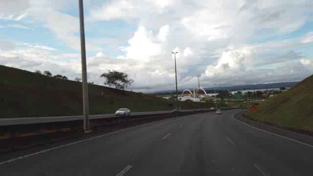 arriving in brasilia and aproaching the paranoa lake and the famous jk bridge. - juscelino kubitschek bridge stock videos & royalty-free footage