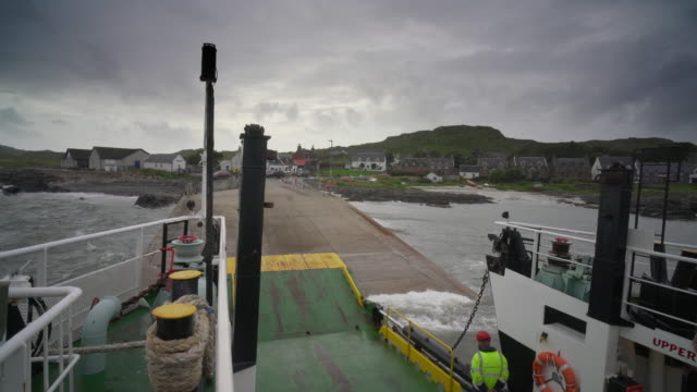 arriving on the island of iona by ferry from mull - pilgrimage stock videos & royalty-free footage