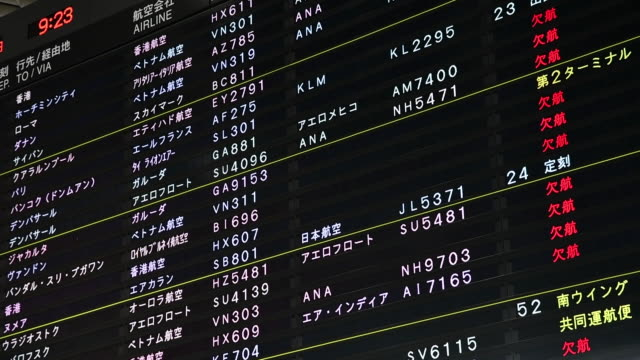 arriving passengers take a coronavirus test at narita international airport in narita chiba prefecture japan on sunday july 19 2020 - flugpassagier stock-videos und b-roll-filmmaterial