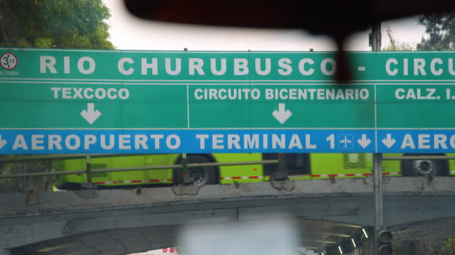 arriving to mexico city terminal 1 by car. aeropuerto terminal 1 banner - road sign stock videos & royalty-free footage