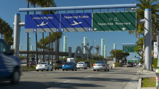 """arriving-departing"" lax traffic sign - lax airport stock videos & royalty-free footage"
