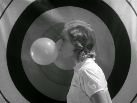 b/w 1938 arrow hits balloon in woman's mouth then bullseye - sports target stock videos and b-roll footage