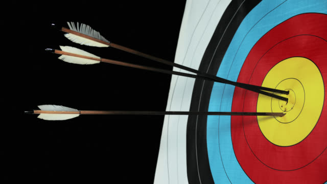 slo mo arrow hitting the centre - dart board stock videos & royalty-free footage