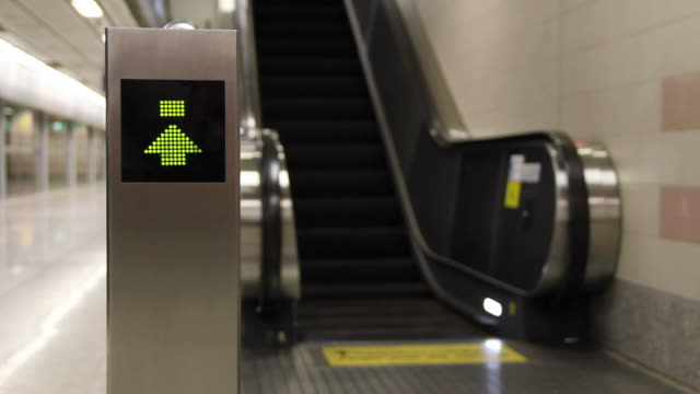 arrow sign to upstairs with escalator. - blinking arrow stock videos & royalty-free footage