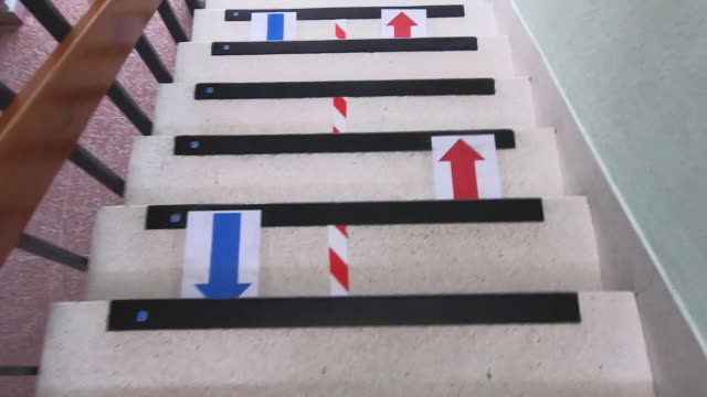 arrow signs on the floor of stairsteps regulating the flow of people to ensure social distance at the paraíso sagrados corazones madrid school on... - self discipline stock videos & royalty-free footage