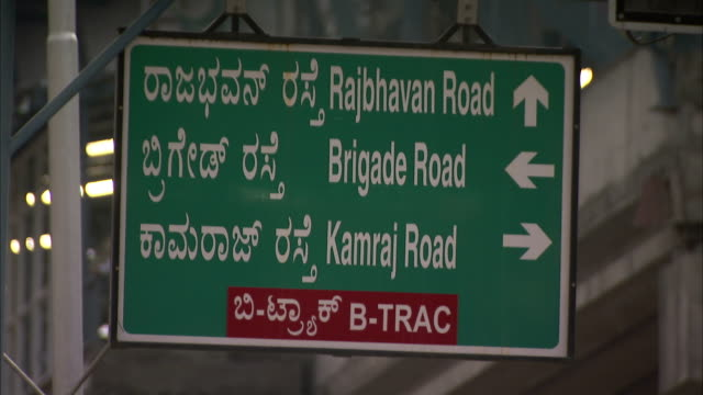 arrows and writing on a road sign provide directions. - indian arrowhead stock videos and b-roll footage