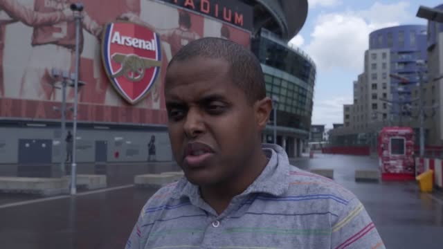 Arsenal and Liverpool fans discuss the latest Transfer Deadline Day news at the Emirates Stadium