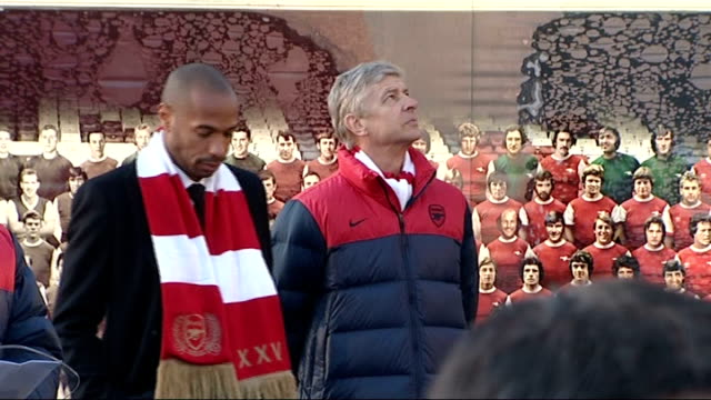 statues unveiled outside Emirates Stadium Peter HillWood speech standing alongside Thierry Henry and Wenger Henry statue unveiled SOT / General views...