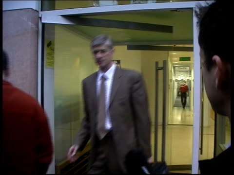 arsenal fined and players banned after manchester united brawl itn ms arsenal manager arsene wenger from football association hq anthony clavane... - アーセン・ベンゲル点の映像素材/bロール