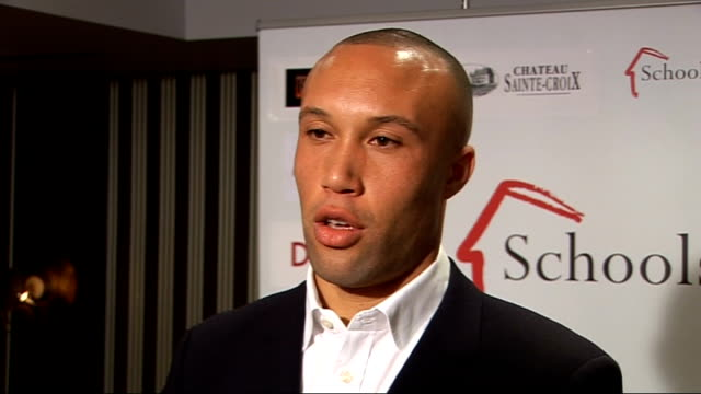 arsenal footballers attend charity event; england: london: hampstead: int schools for hope backdrop / mikael silvestre giving interview to french... - silvestre bildbanksvideor och videomaterial från bakom kulisserna
