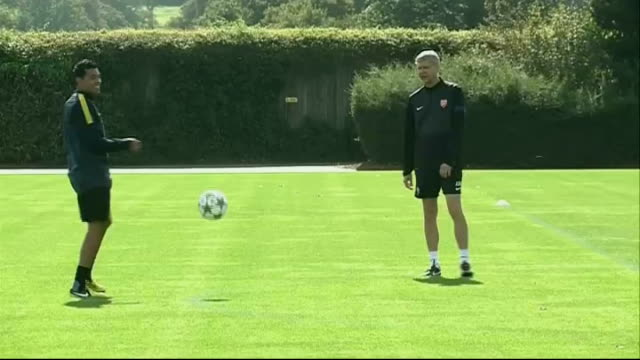 Hertfordshire London Colney EXT General views of players along / Arsene Wenger along / Andre Santos running / Santos and Wenger kicking ball to each...