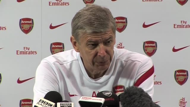 arsenal manager arsene wenger on race rows blatter and his side's current form ahead of their next game against norwich on november 19 2011 in london... - アーセン・ベンゲル点の映像素材/bロール