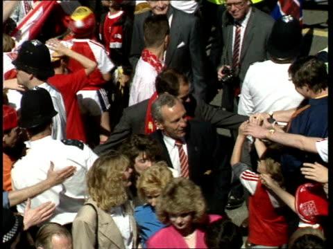 Arsenal Parade with Football League Cup England London Islington Town Hall Team through crowds / players climb out through Islington Town Hall window...