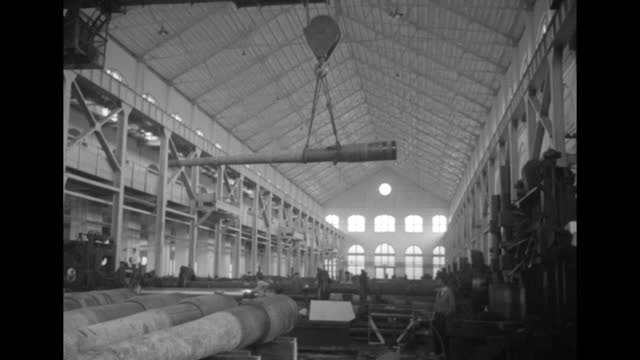 arsenal room, ceiling crane moving gun barrel away from camera in fg / note: exact day not known - gun barrel stock videos & royalty-free footage