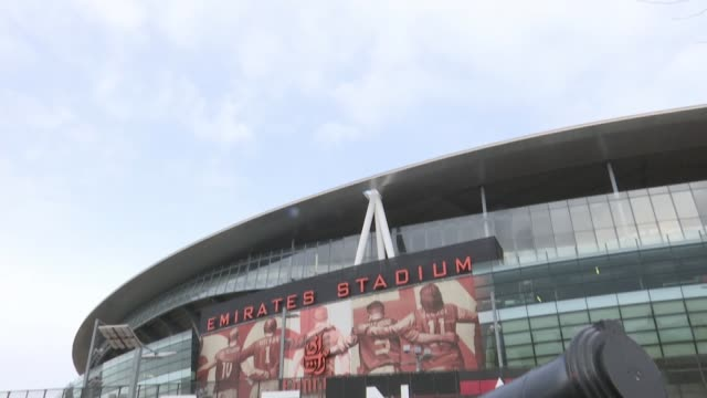 arsenal supporters want arsene wenger to leave club england london ext **music heard sot** emirates stadium tilt down cannons - アーセン・ベンゲル点の映像素材/bロール