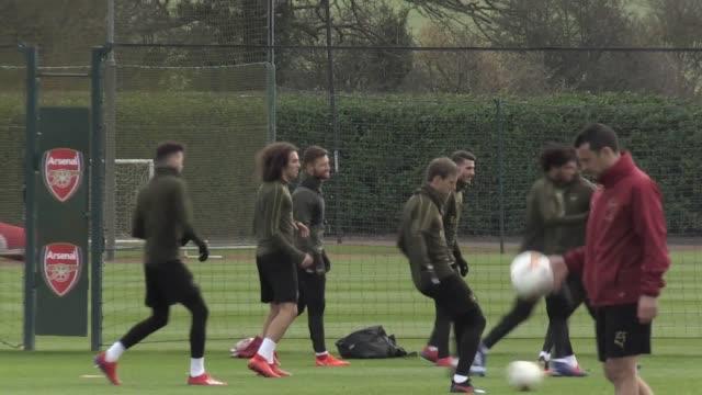 Arsenal train ahead of their UEFA Europa League game against BATE on February 21 Players include Mesut Ozil Aaron Ramsey Pierre EmerickAubameyang...