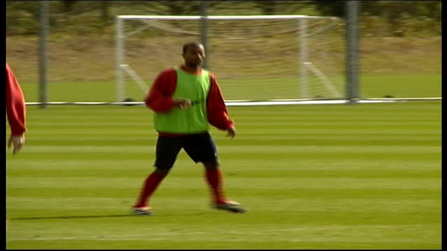 Arsenal train for Champions League match against Valencia ITN London EXT GVs Arsenal players training at training ground Tony Adams training Freddie...
