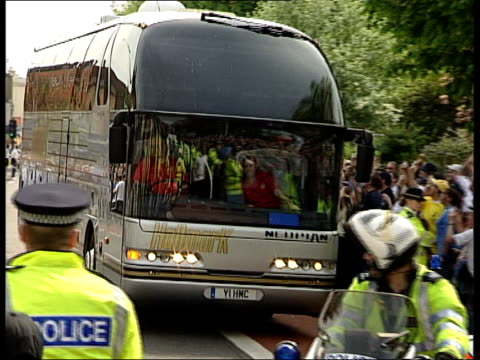 arsenal win premier league title at home of rivals tottenham itn london white hart lane arsenal team coach arriving at ground pan - rivalry stock videos and b-roll footage