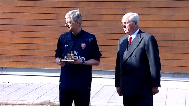 Arsene Wenger celebrates his 1000th game in charge of Arsenal ENGLAND Hertfordshire London Colney Arsene Wenger presented with small gunners statue...