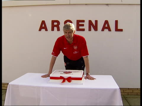Arsene Wenger posing with cake to celebrate 10 years in charge at Arsenal ENGLAND London Colney INT Arsenal Manager Arsene Wenger posing for...