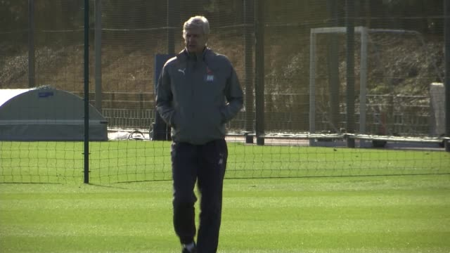 arsene wenger signs new two year contract with arsenal lib / 632017 colney arsene wenger along pitch at training session end lib - アーセン・ベンゲル点の映像素材/bロール