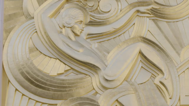 cu art deco carving on folies bergere building / paris, france - dissolvenza in chiusura video stock e b–roll