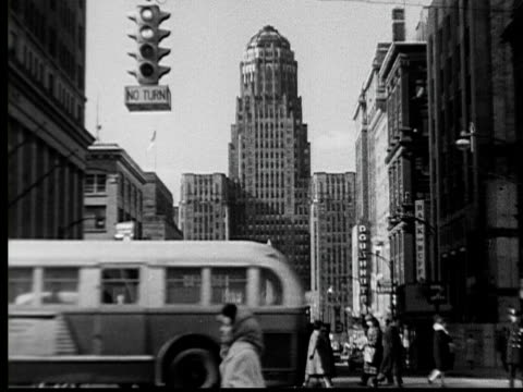 stockvideo's en b-roll-footage met 1955 ws art deco city hall building with traffic and people moving through intersection in foreground/ buffalo, new york - 1955