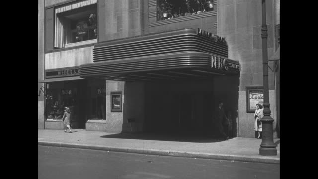 art deco entrance to rockefeller center nbc studios and rainbow room marquees pedestrians walk past / note exact year not known - nbc stock videos & royalty-free footage