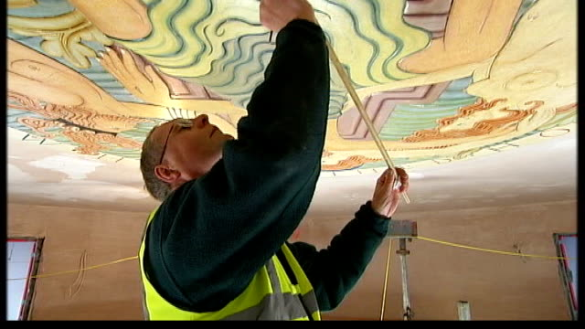 art deco hotel in morecambe is renovated building work taking place inside hotel brian cardy restoring ceiling mural builder removing plastic... - relief carving stock videos & royalty-free footage