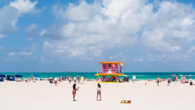art deco style lifeguard hut on south beach, ocean drive, miami beach, miami, florida, usa - time lapse - hut stock videos & royalty-free footage