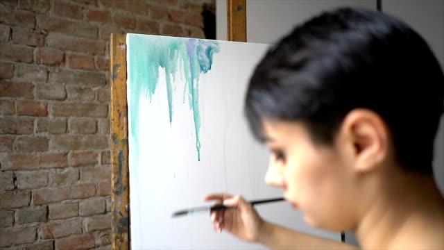art in the making - tela di canapa video stock e b–roll