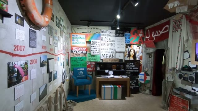 art installations about the history and on going israel/palestine conflict displayed at the small museum inside the walled off hotel by acclaimed... - israel palestine conflict stock videos and b-roll footage