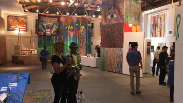 vídeos de stock, filmes e b-roll de art show opened in houston texas that portraits different art items critical to the potus more than 20 artists showed their work in this exhibit... - medium group of objects