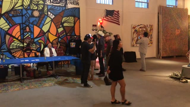art show opened in houston, texas that portraits different art items critical to the potus. more than 20 artists showed their work in this exhibit,... - curator stock videos & royalty-free footage