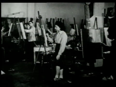 1946 montage art students standing at easels painting in classroom / new york, new york, united states  - paintbrush stock videos & royalty-free footage