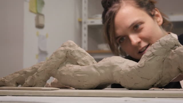 art studio. young woman making a sculpture. - sculptor stock videos & royalty-free footage