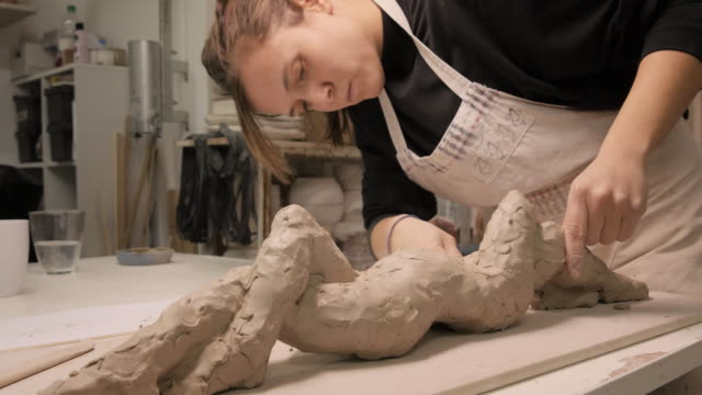 art studio. young woman making a sculpture. - craft product stock videos and b-roll footage
