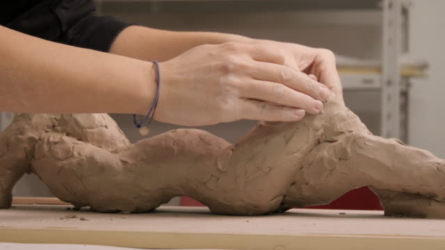 art studio. young woman making a sculpture. - art class stock videos & royalty-free footage