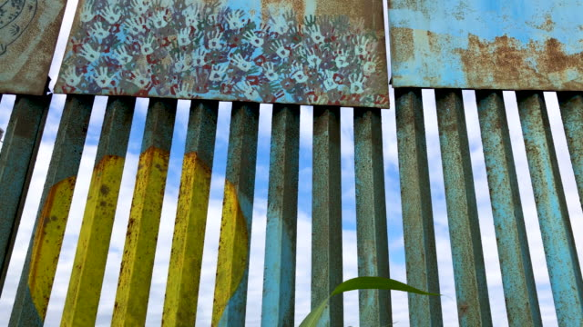 art work is displayed on usmexico border fence on the beach on september 28 2019 in tijuana mexico the artwork is part of the playas of tijuana mural... - deported stock videos & royalty-free footage