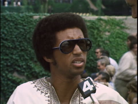arthur ashe discusses playing tennis in the previous years - ヒト免疫不全ウィルス点の映像素材/bロール